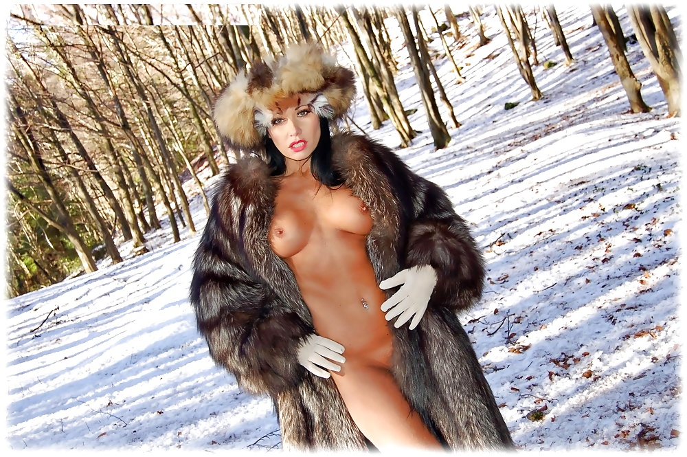 The brunette girl in fur satin bloom doesn't wear anything but her coat on