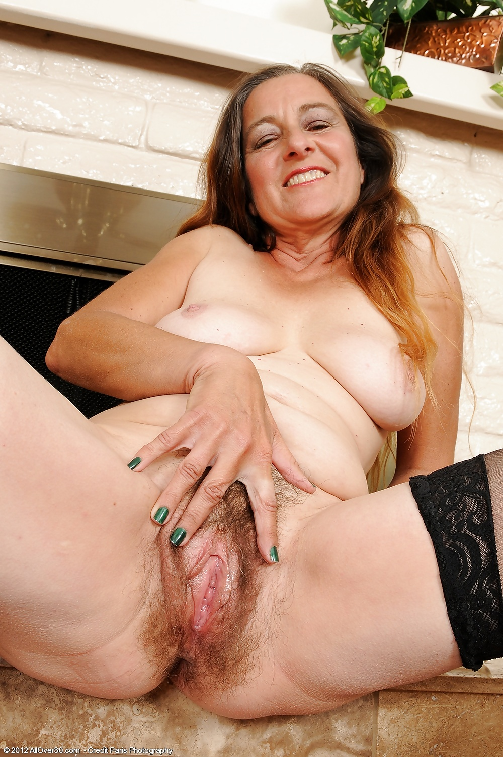 Delicious big tits and bald pussy of sexy mature woman