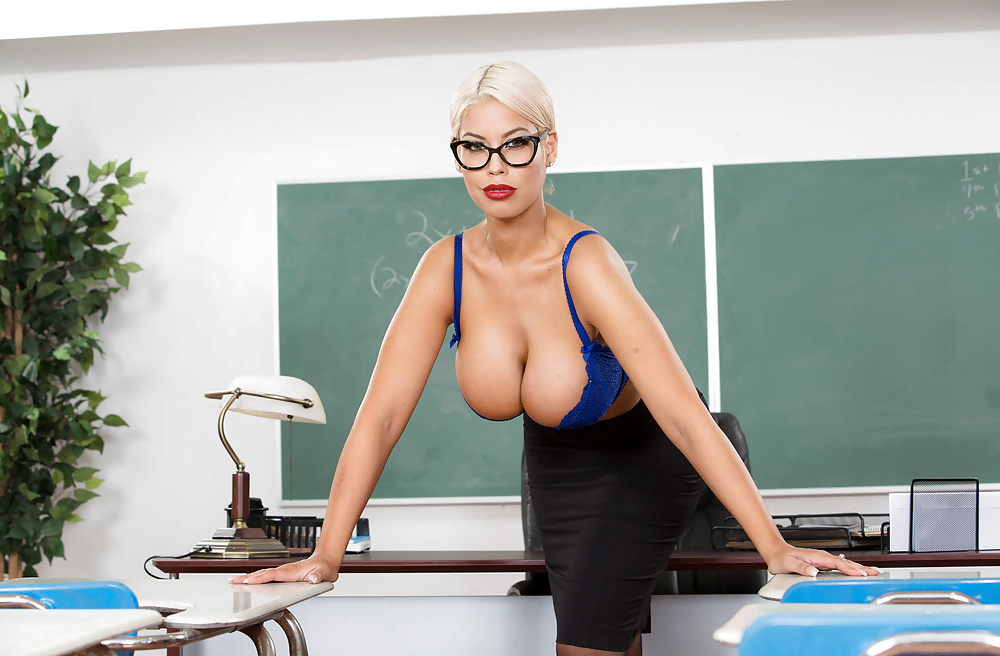 Big boob teacher mellisa and her young student fuck in classroom
