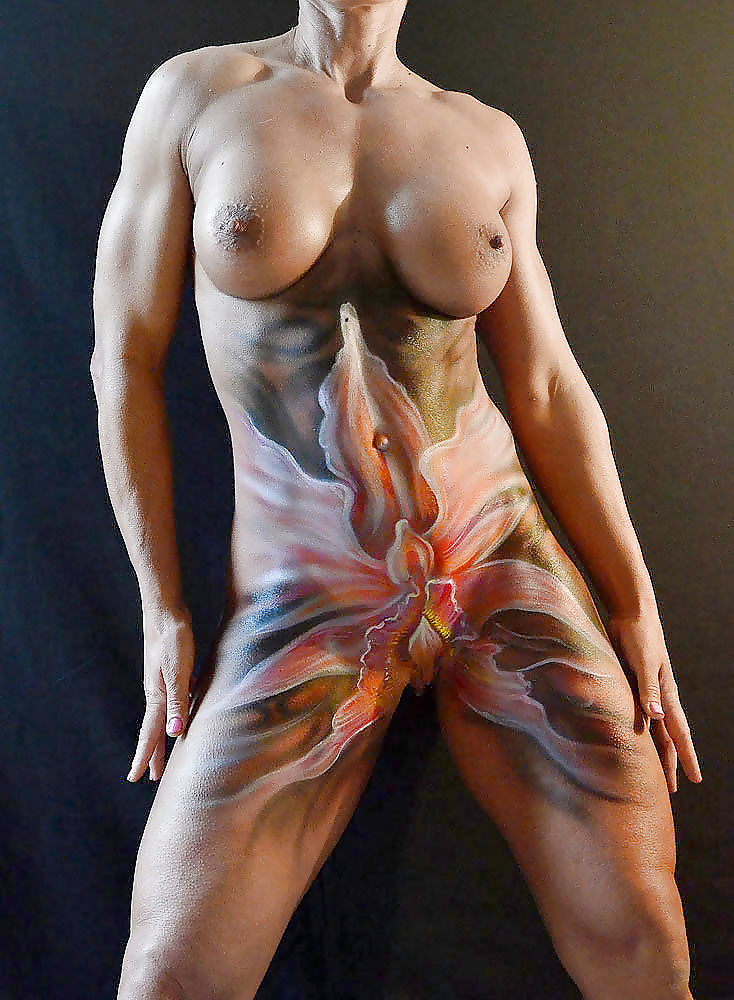 Body painting on a boat with alluring naked ladies