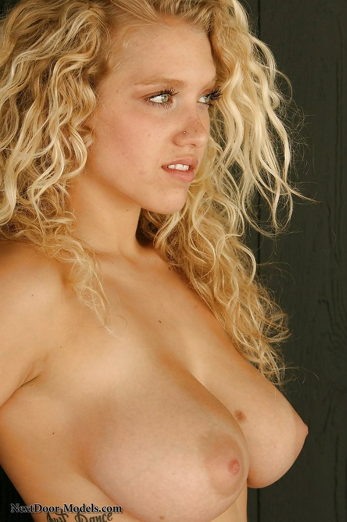 Sexy blonde busty curly