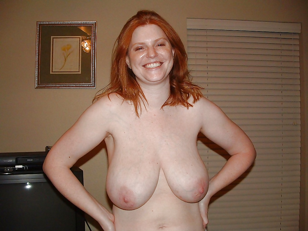 Young blonde with big saggy breasts sandra posing with her top off