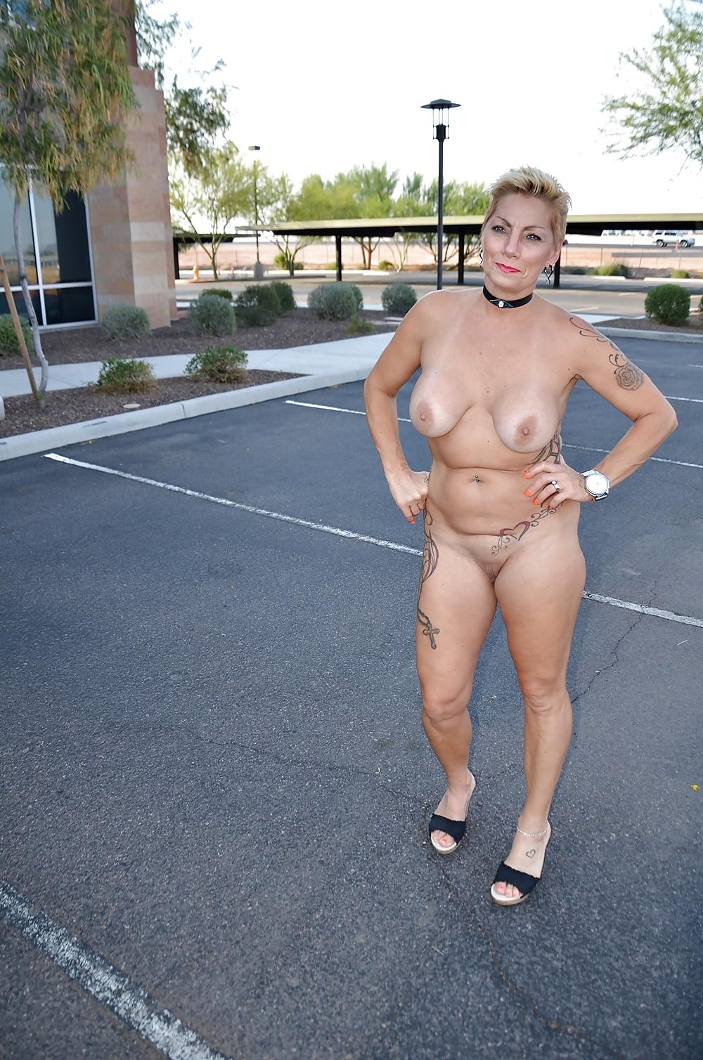 Milf sripped nude in public — photo 3