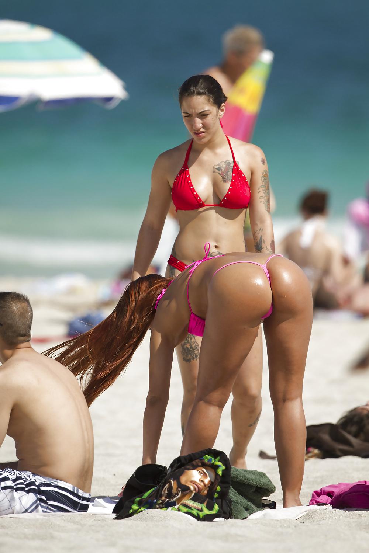Woman legs beach seaside the beach seashore ass swimming trunks man stock photo
