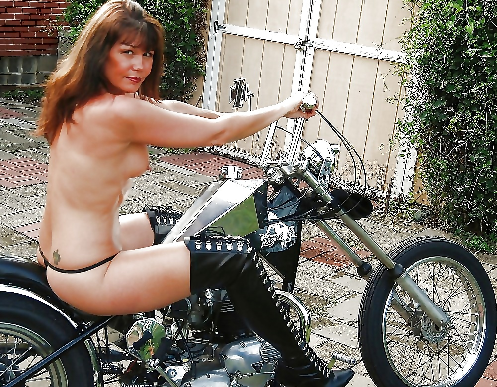 Hot nude girl riding on motorcycle