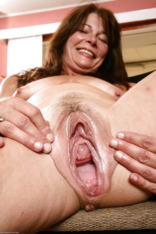 Spreading wet hairy mature vagina labia close