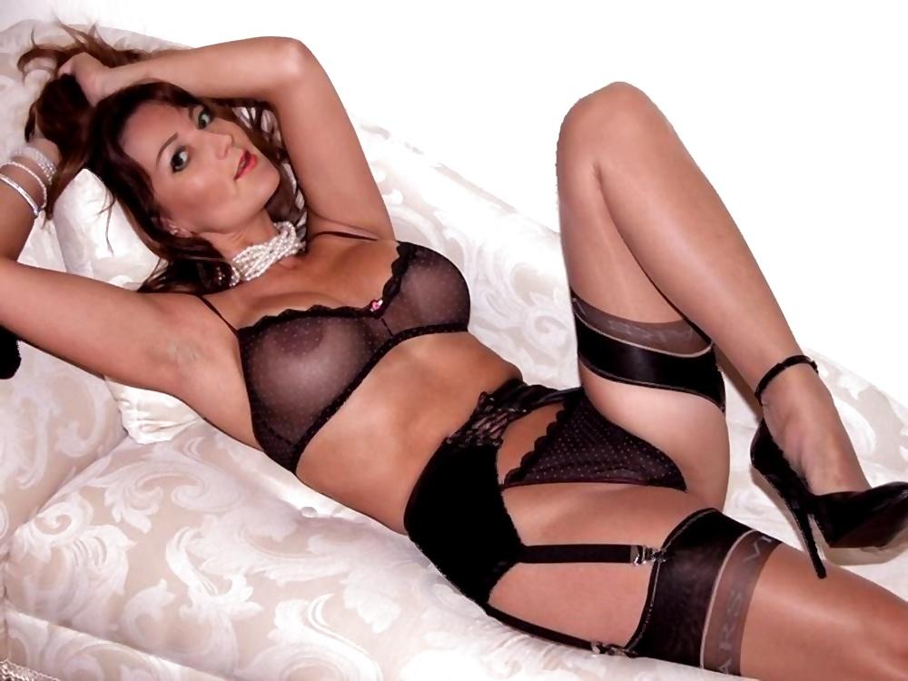 Woman putting on black stockingsbeautiful sexy stock photo