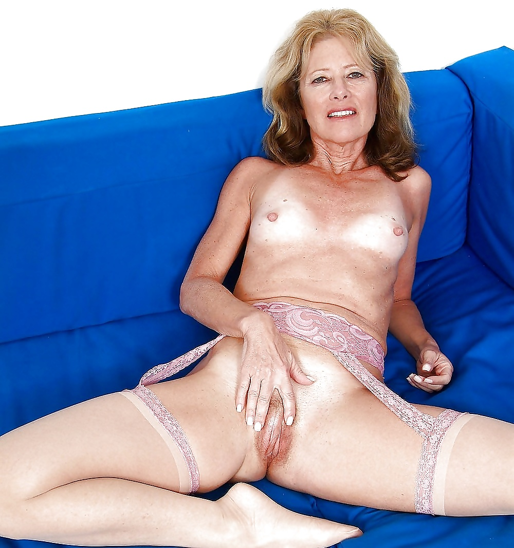 A mature woman stripping outdoors in these pics