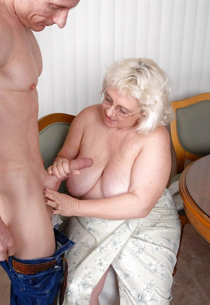 Spectacled mature woman gives great handjob