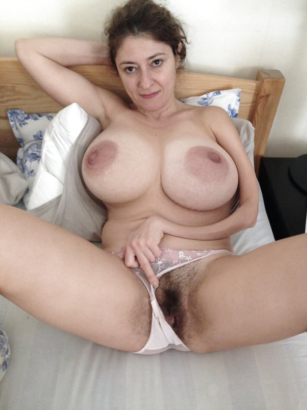 Mature asian babe with huge boobs spreading her hairy pussy