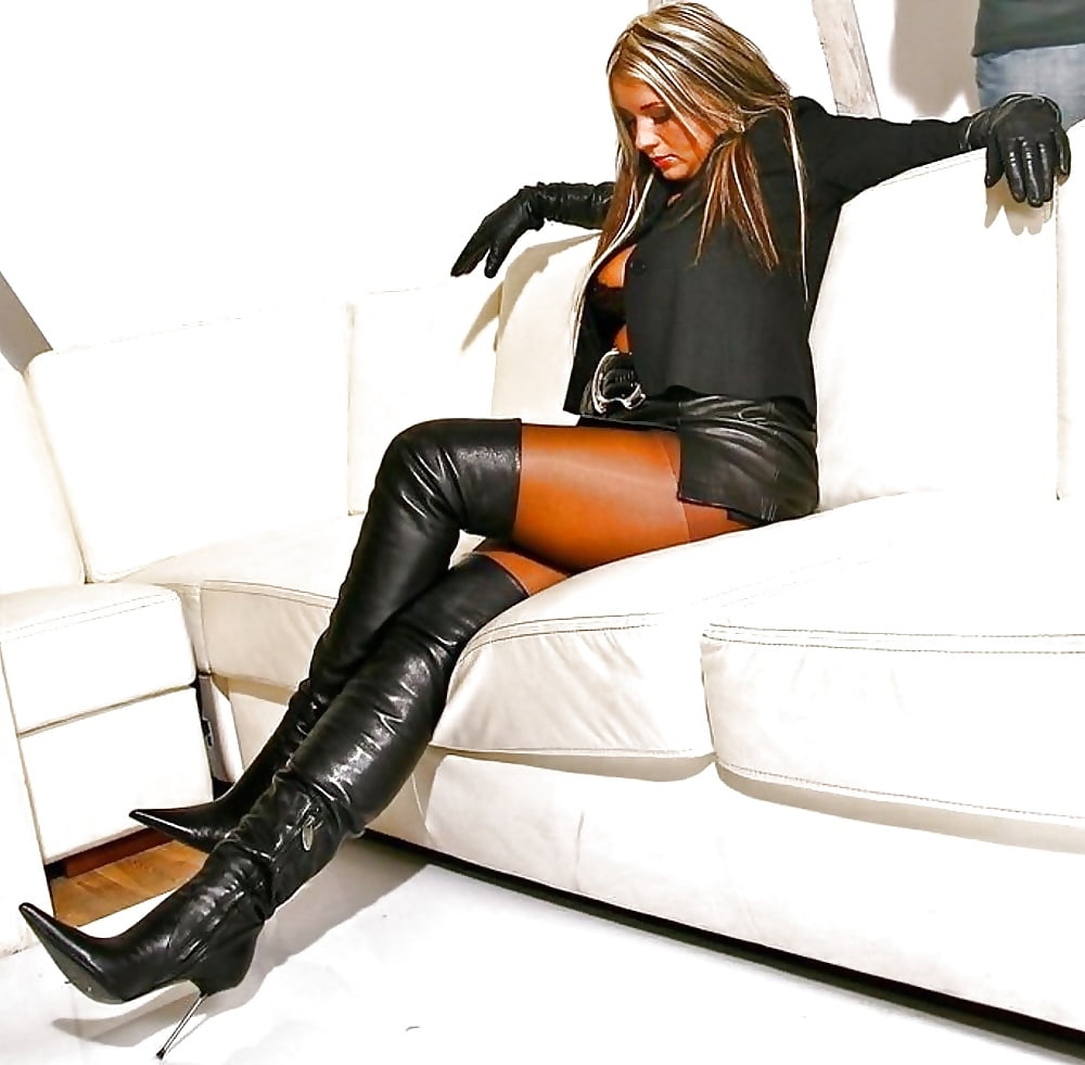 Legs with leather mini skirt stock image