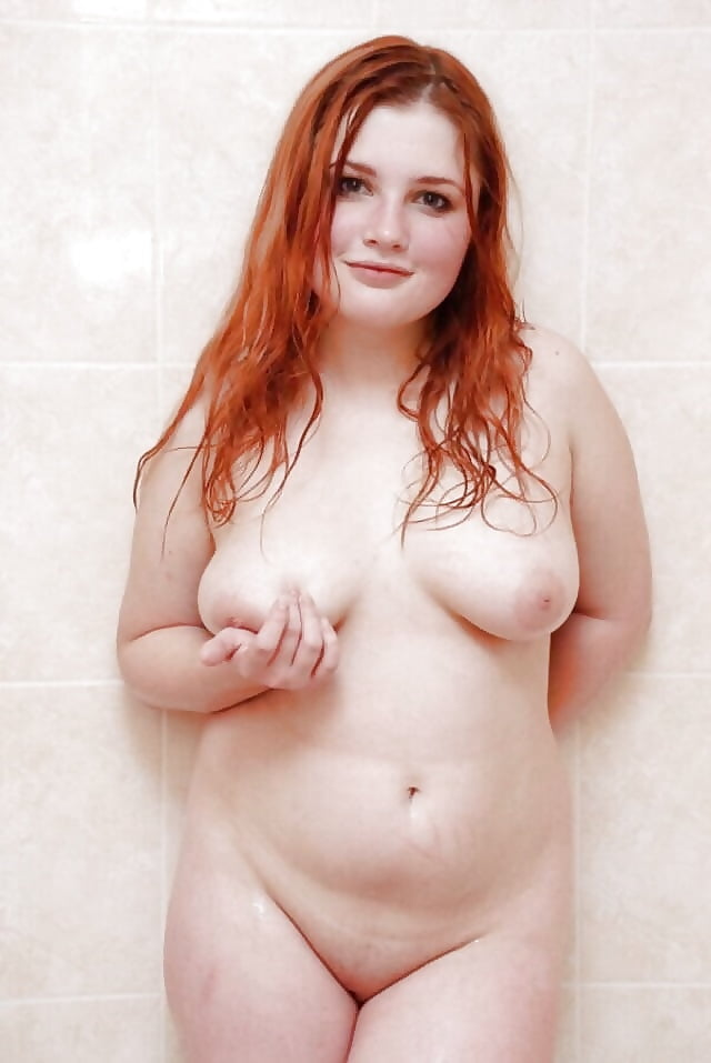 Chubby redhead mature woman demonstrating appealing features