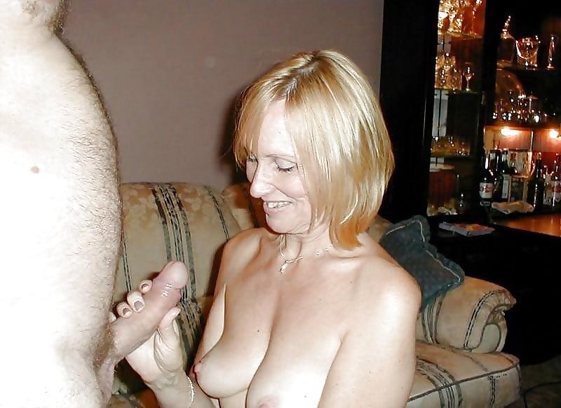 Old woman giving hand job