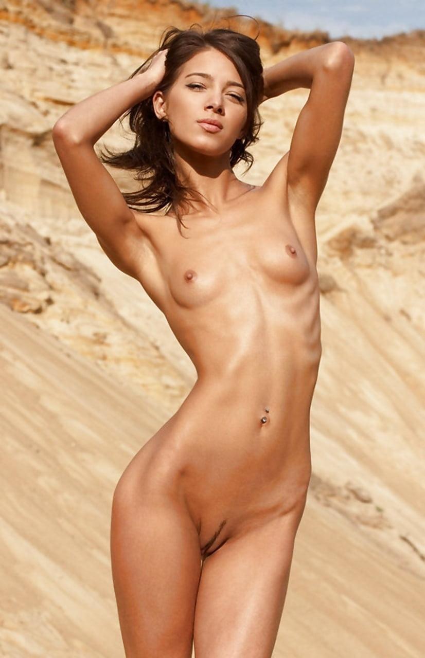Pretty slim girl nude on knees