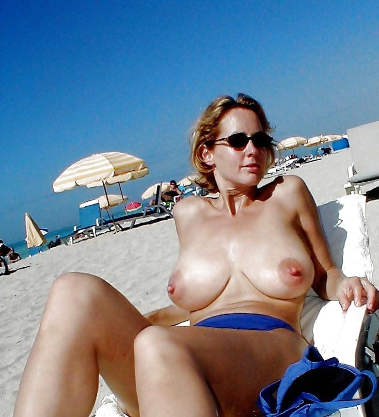 Nude topless beach mom smoking nude