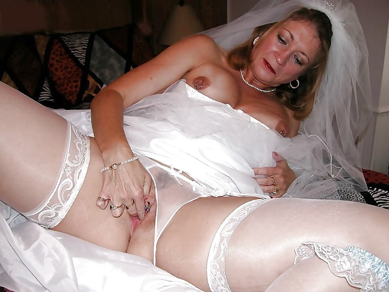 Hot mature bride on bed