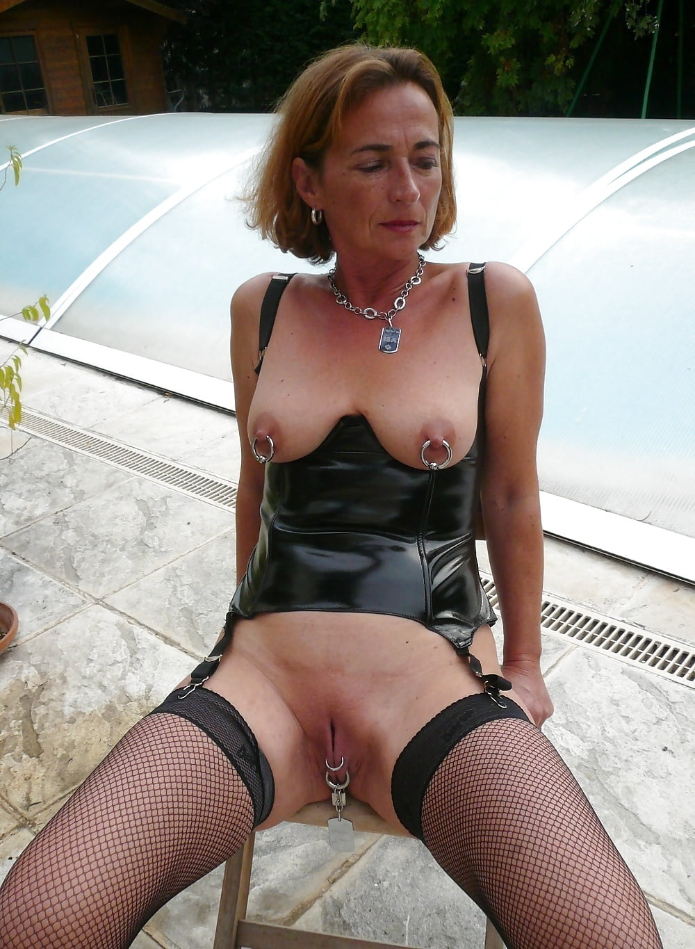 Amateur milf with pierced nipples gets fucked in her corset