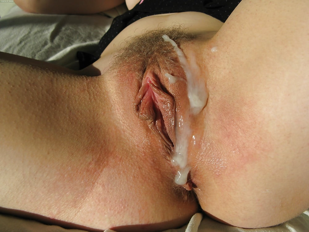 Cum dripping slowly out of black pussy