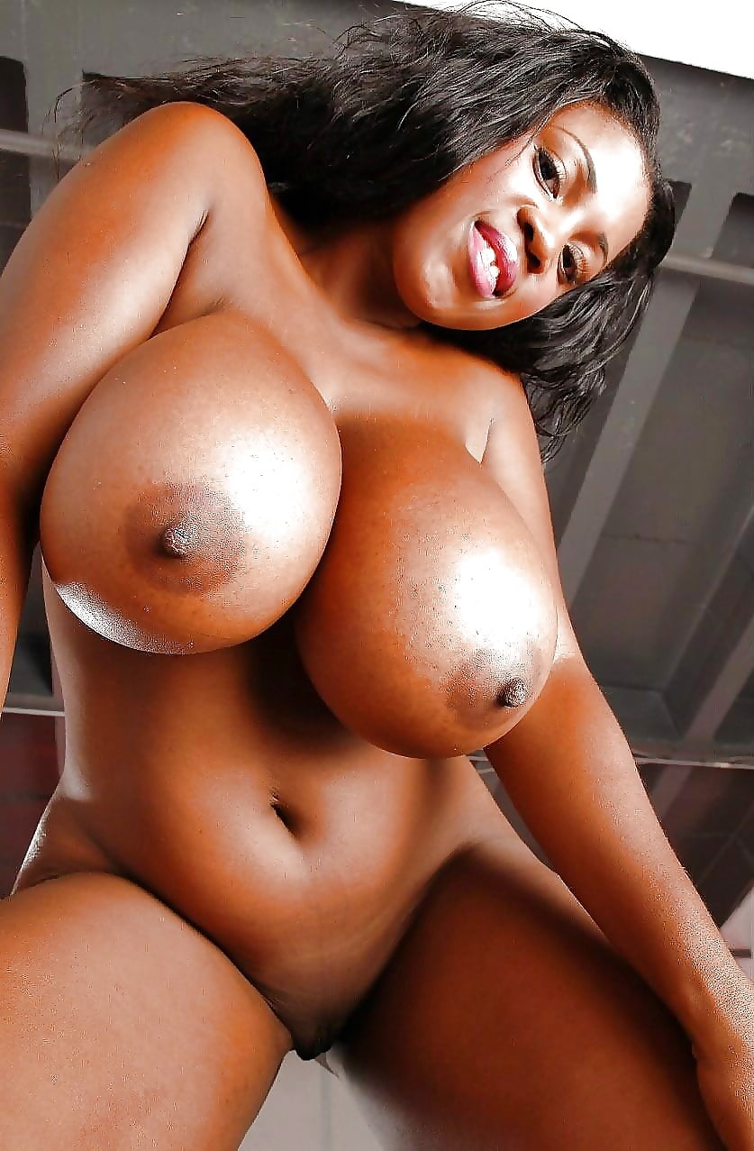 Sexy black girl showing her big natural boobs