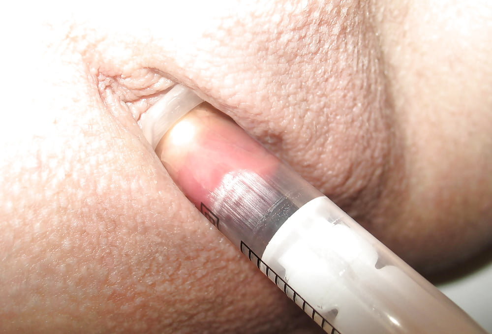 Saline injection in her pussylips by faustinchen