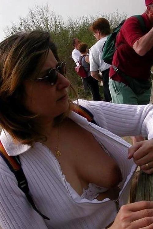 Lea michele lets a nipple slip out of her bikini