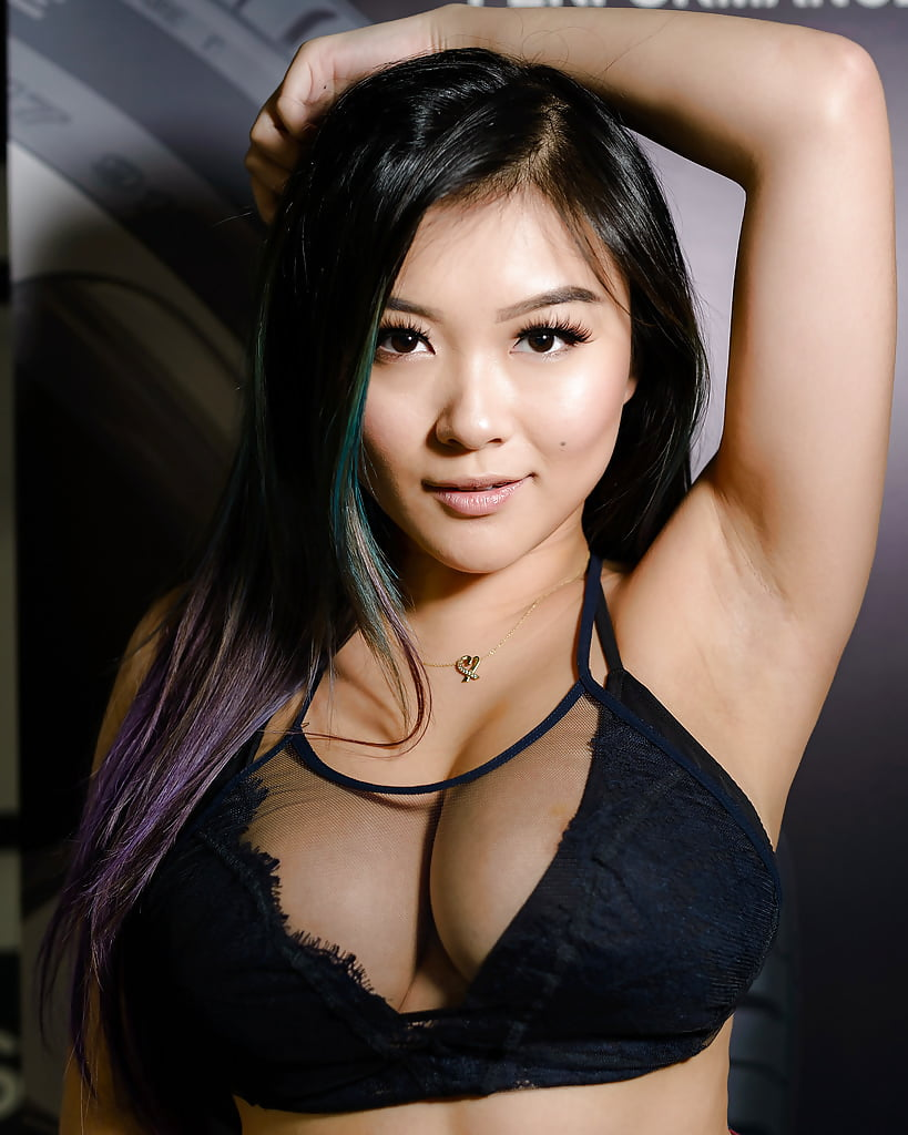 Busty asian pornstar with pink lingerie under her skirt and tiny blouse stripping