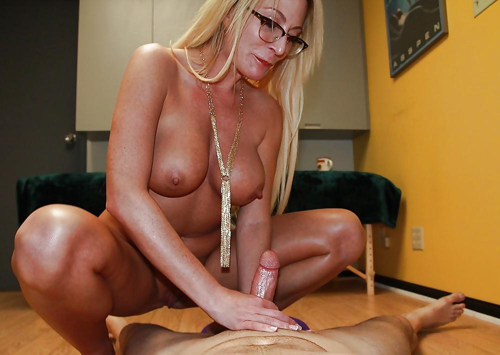 Sexy mature lady giving handjob