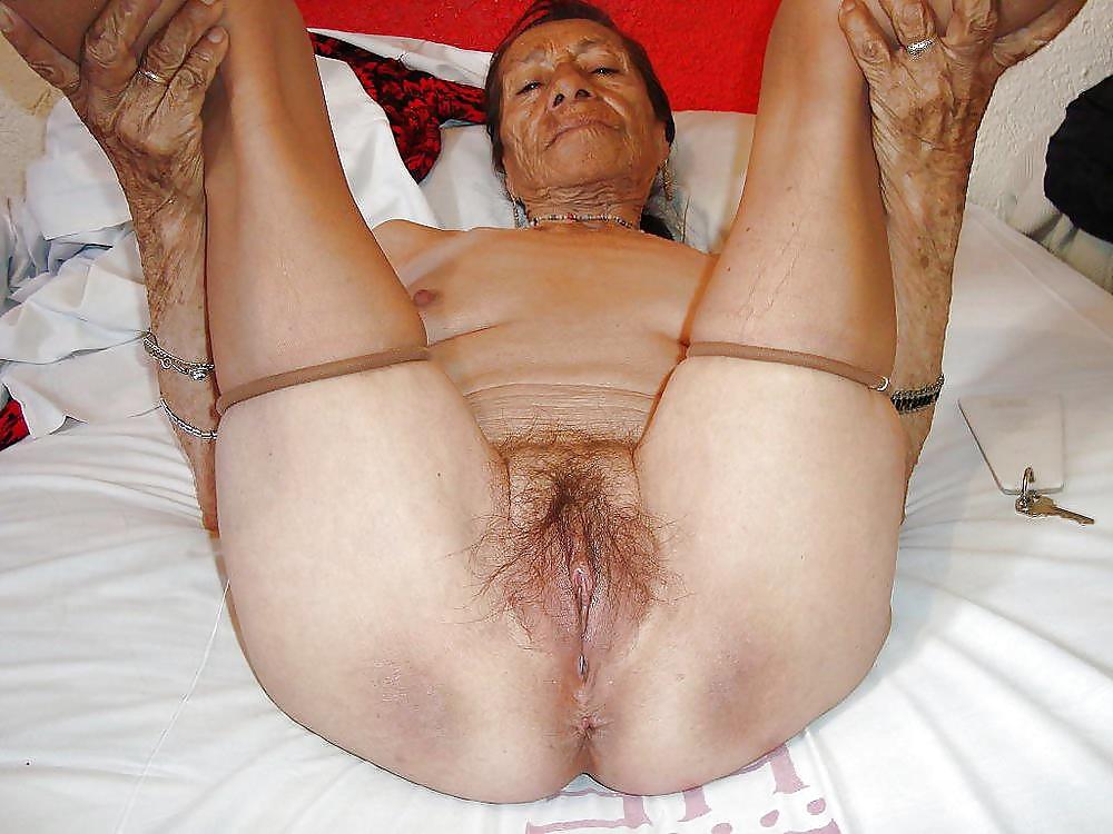 Very wrinkled old granny spreading