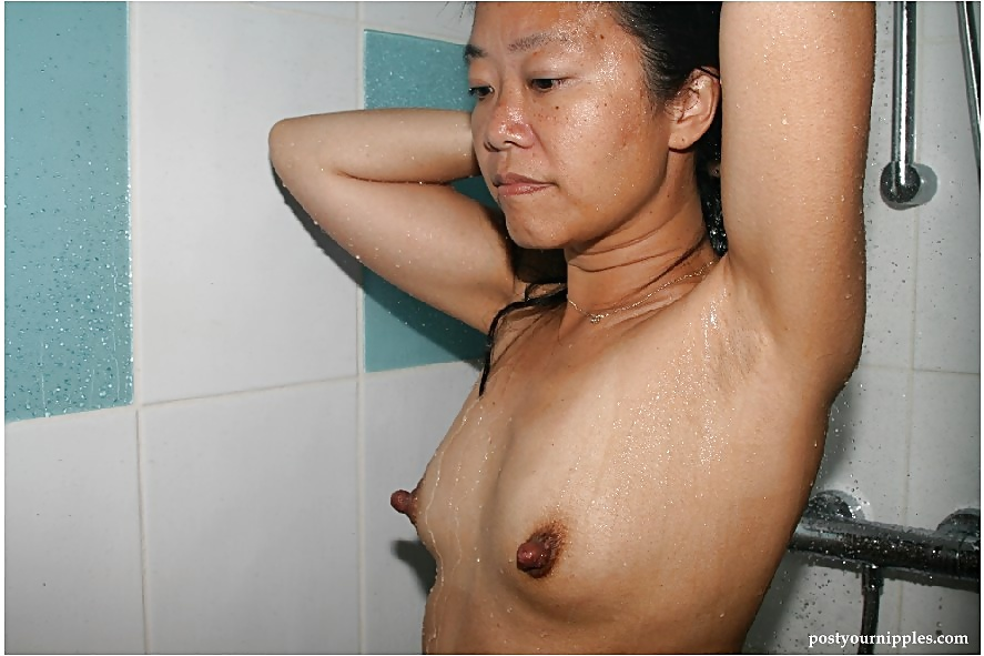 Stocking and skirt garbed asian amateur revealing big tits and hard nipples