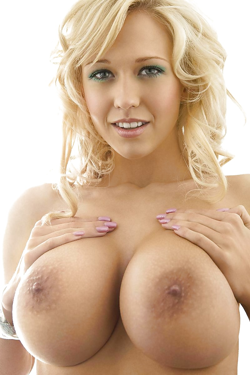 Sexy blonde with big breasts in a white