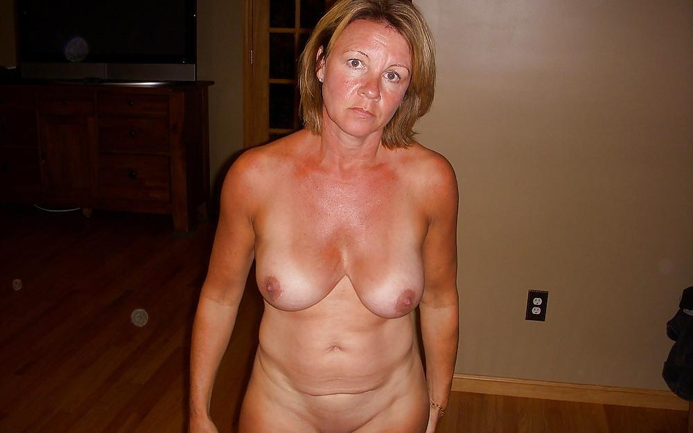 Topless mature woman naked selfshot