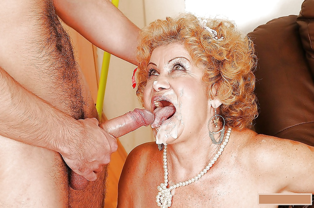 Granny with blond hair sucks balls and licks a huge cock of a young dude