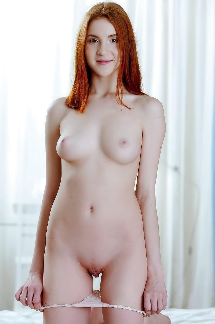 Teen thin redhead shows pics