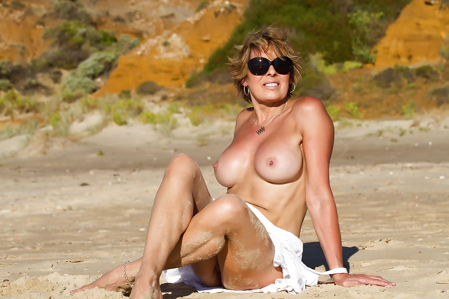 Dripping wet nude milf on the beach