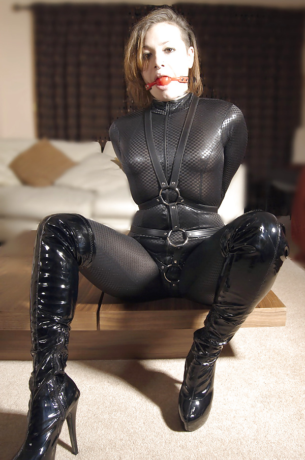 Sandy In Fetish Latex Outfit Posing And Dildoing Her Tight Babe Source 1