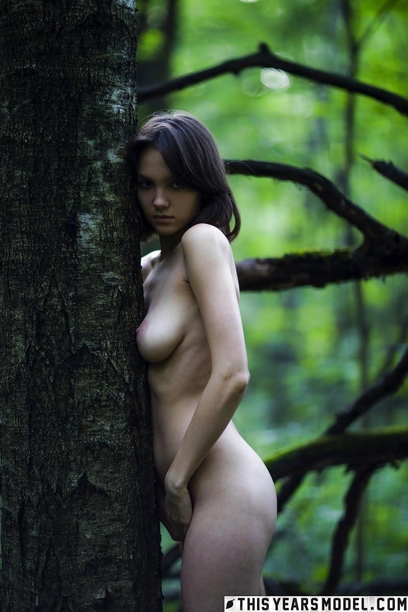 Girl left naked in the wood