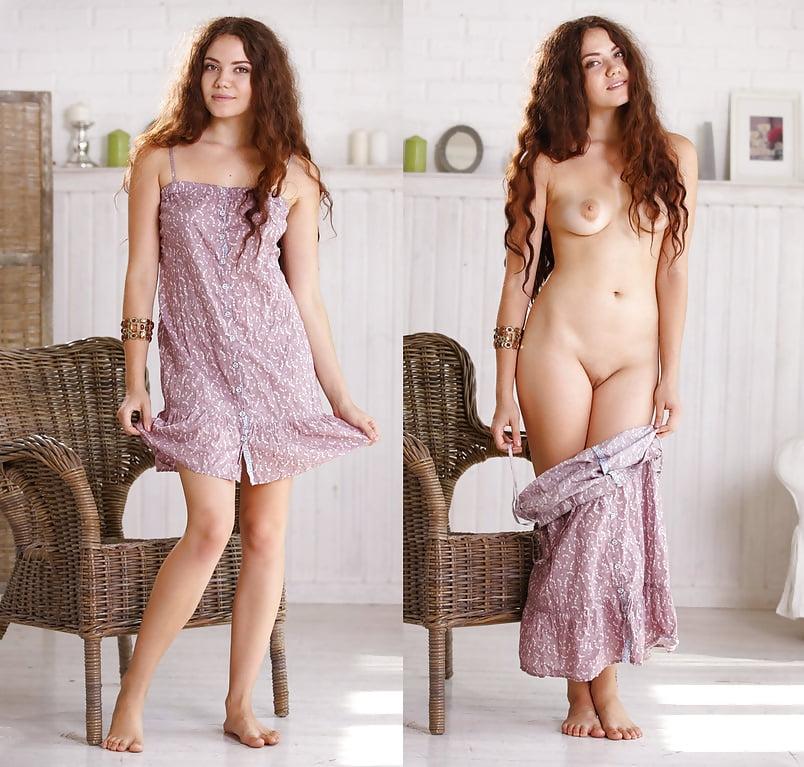 Cute girl undressing in a field