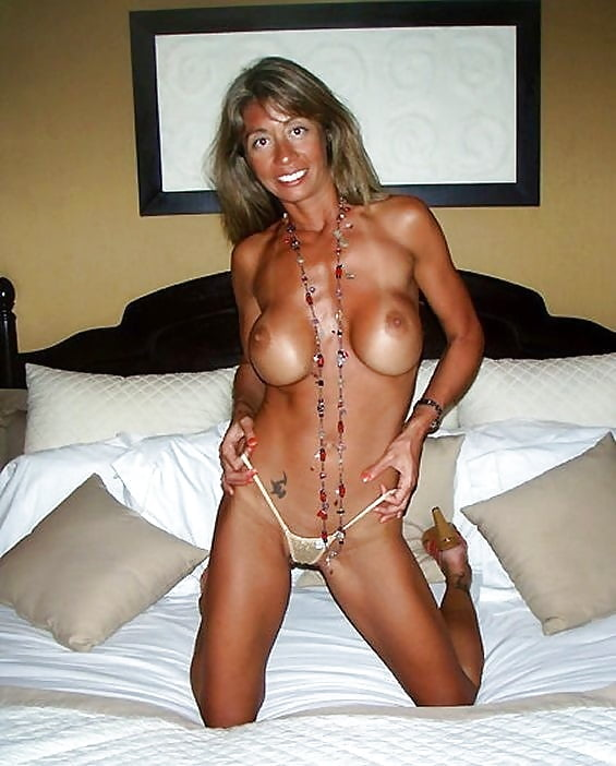 Sexy blonde mature with tan lines