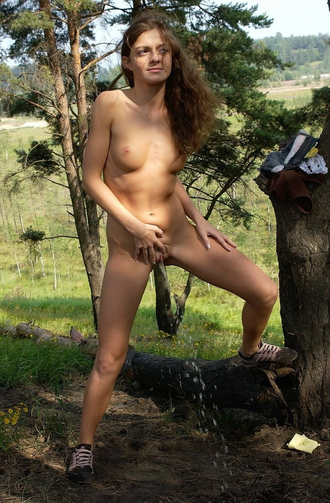 Naked Girl Pees Standing Up