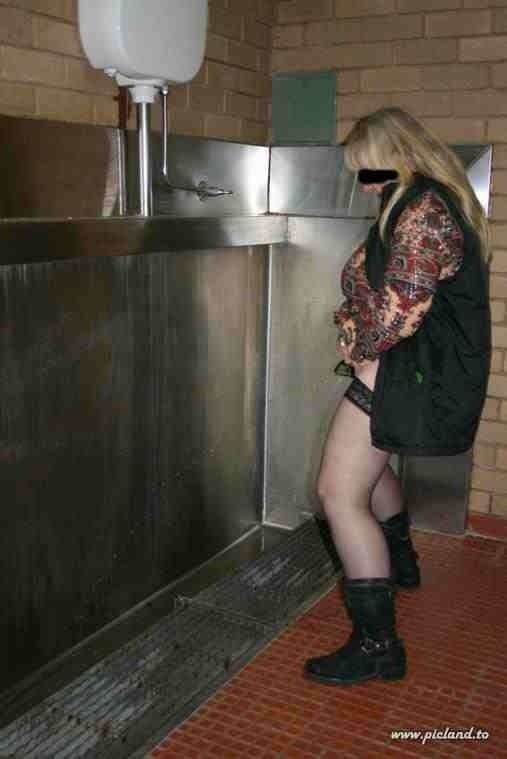 Pissing In Urinal