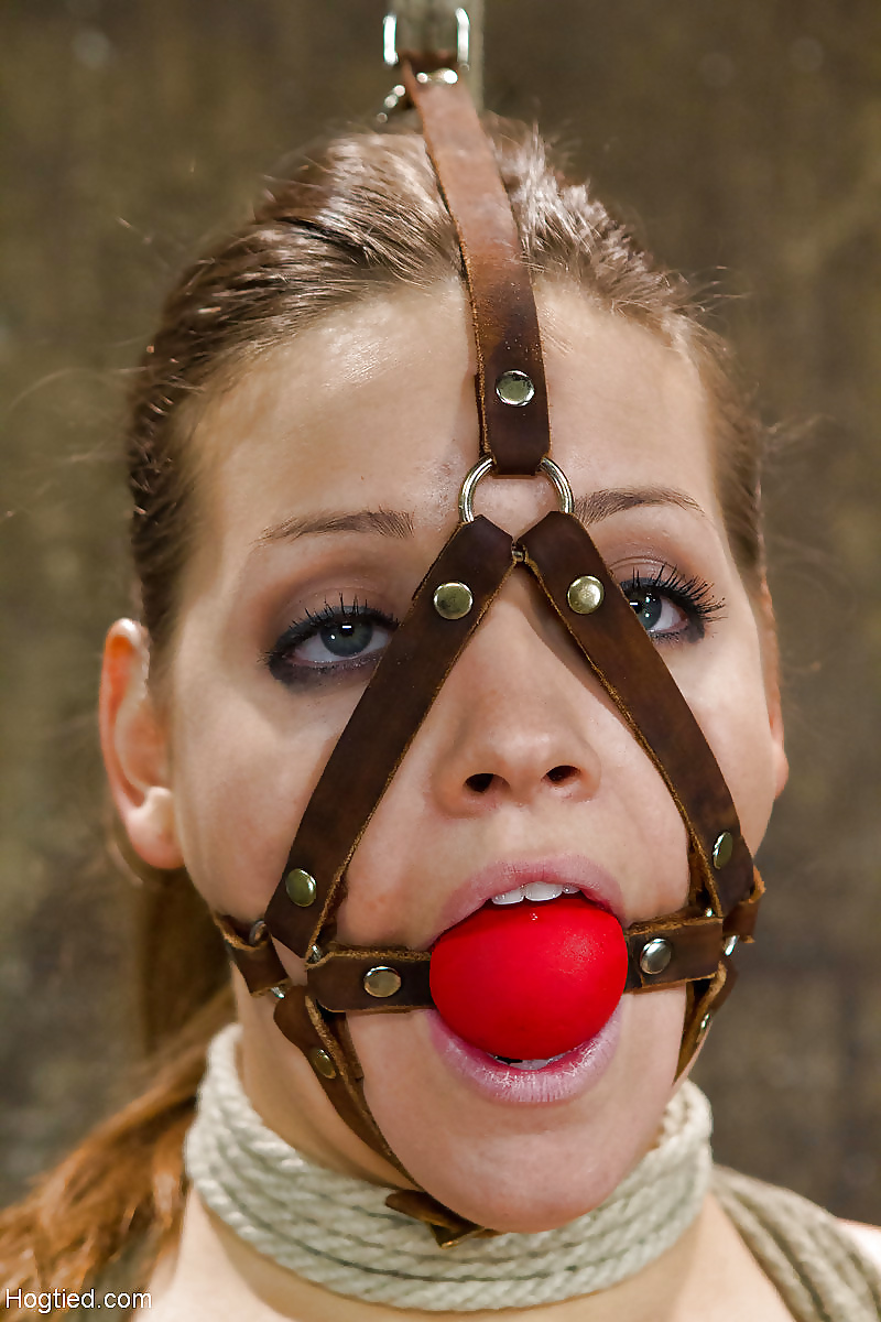 Brunette gets a ball gag while being fucked