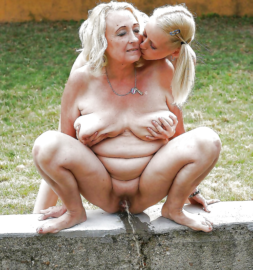 Granny with a big ass and fanny pissing in a public toilet