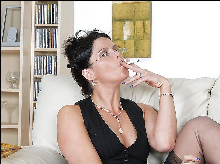 Mature woman smoking cigarette, portrait
