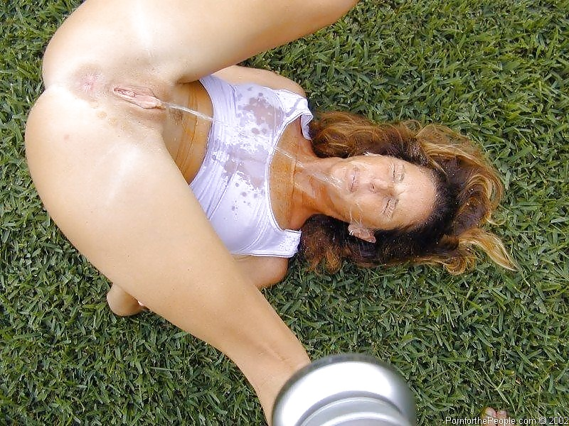 Naked women drinks pee