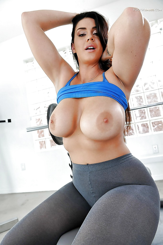 Brunette with comically large tits and tight yoga pants gets fucked