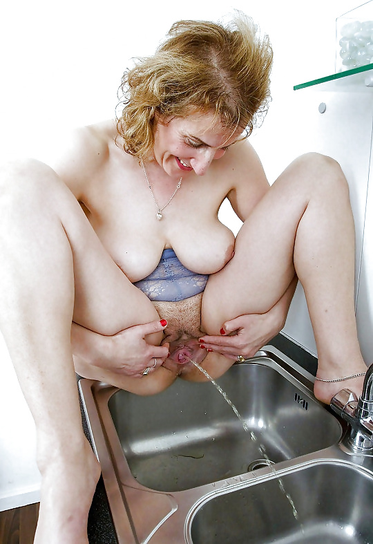 Older women pissing young girls — photo 14