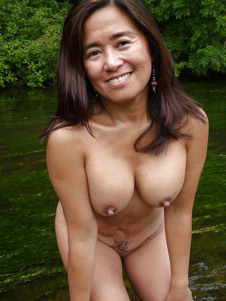 Charming asian mature woman smiles