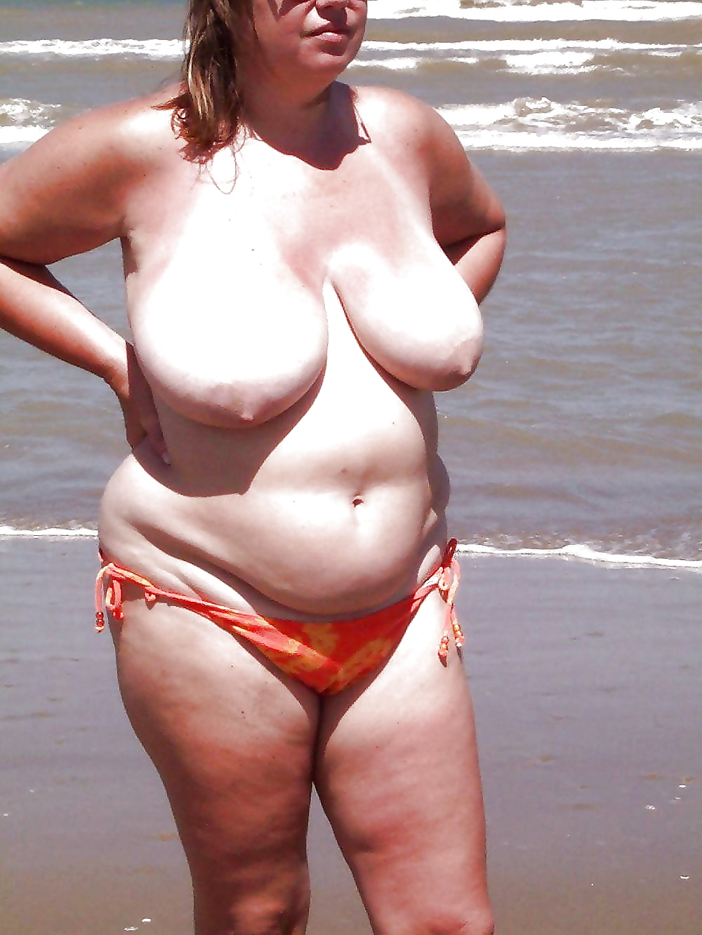 Fat Granny Sits Topless And Displays Her La