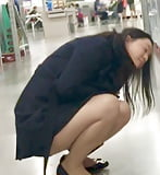 Young Chinese milf getting her squats done at store! (25)